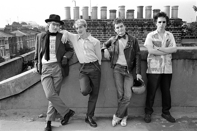 WEB2_Group_image_of_the_band_on_the_roof_of_John_Lydon-s_home_in_Gunter_Grove_(1978)_(c)_Dennis Morris_all rights reserved