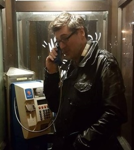 Paul in Phone Booth crop